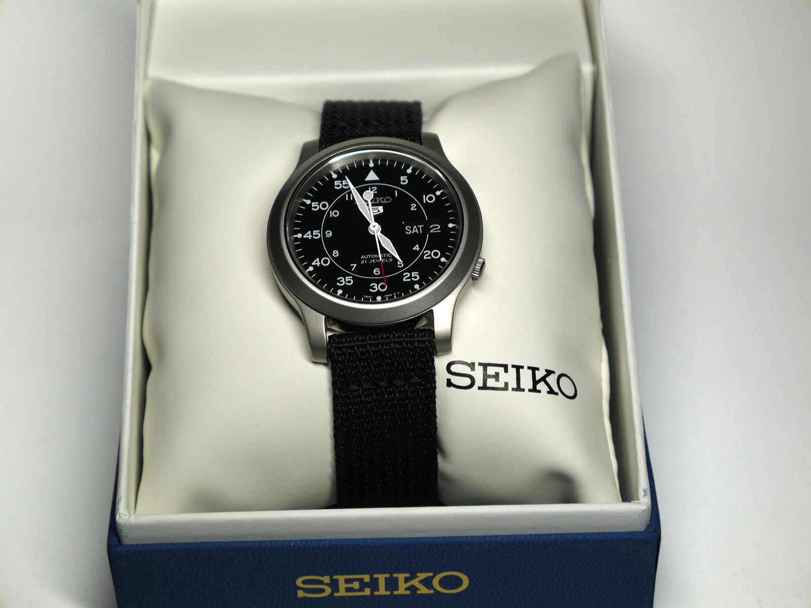 Seiko 5 SNK809 Automatic Stainless Steel Watch with Black Canvas Strap
